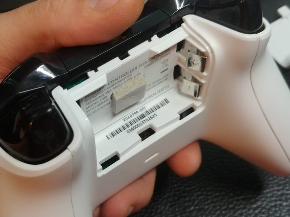 Take a small piece of the Low-Density Foam Weatherstrip Tape and place it, sticky side down, in the center of the controller.