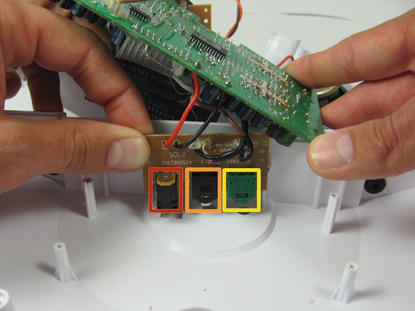Lift up the circuit board containing the Auxillary, DC, and sub inputs and move the lower case out of the way.