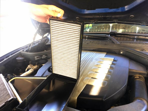 Depress the clips using your thumbs to remove the air filter.