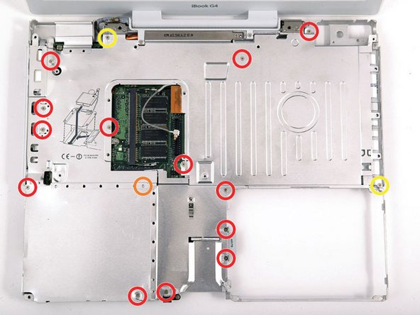 The screw circled in orange may not be present in some models.