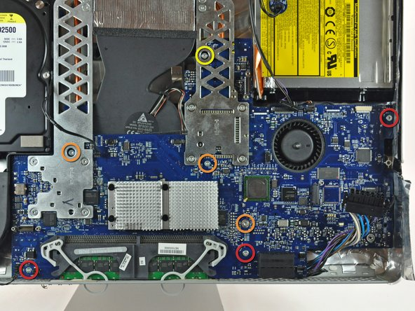 Remove the following seven screws securing the logic board to the rear case: