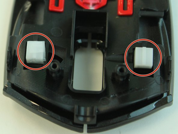 Cover both buttons with tape to increase the surface area of each click.