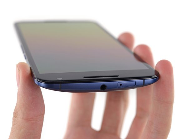 Image 2/3: The top of the phone is decked with a 3.5 mm headphone jack and a seemingly out-of-place nano SIM card slot.