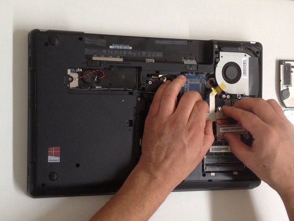 Remove the 2x screws from the Fan module.