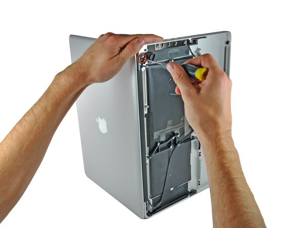 Be sure to hold the display and upper case together with your other hand. Failure to do so may cause the freed display/upper case to fall, potentially damaging each component.