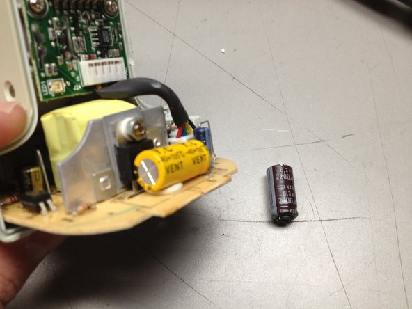 Resolder new capacitor in place, noting the correct polarity.