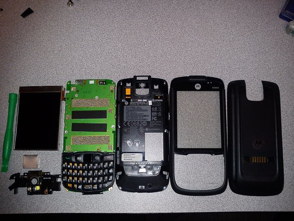 Take the battery cover and battery out of the device and put the unit on its front.