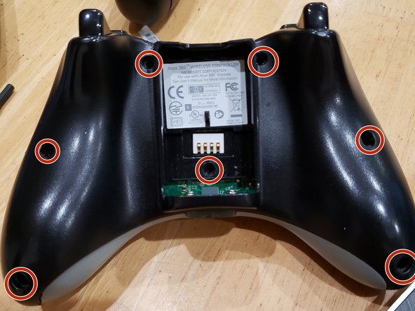 Remove 7 screws using the T3 Toolbit located on the back of the controller.