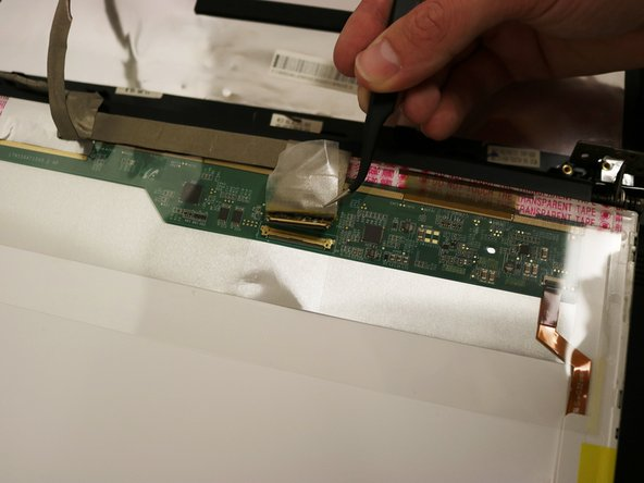 Carefully separate ZIF wire-to-board connection by pulling metal tweezers in a downward motion.