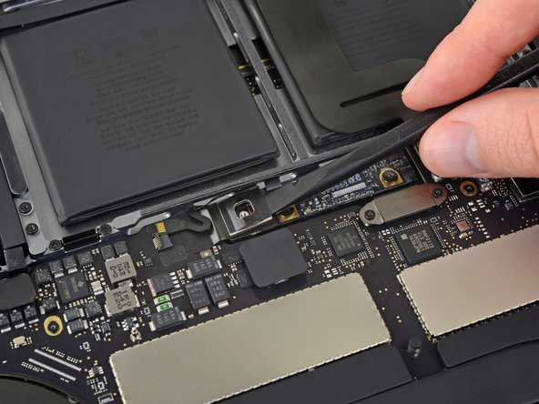 Use a spudger to gently lift the battery power connector, disconnecting the battery.