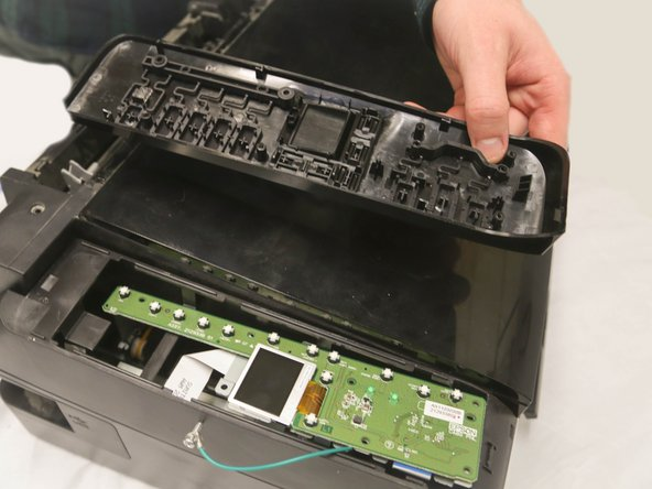 After unscrewing, carefully lift the plastic part of the control panel away from the circuit board.