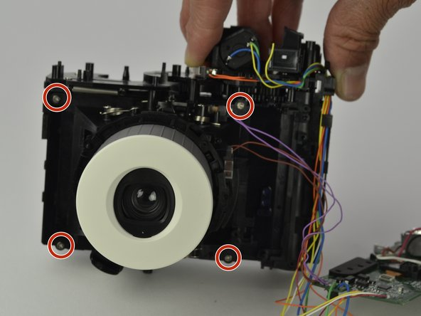 Once the circuit board is off and to the side, remove the four 4.5 mm screws that are around the front lens case using a Phillips #00 screwdriver.