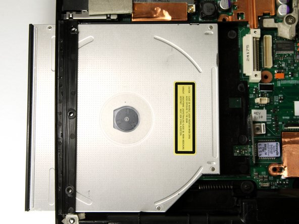 Slide the optical drive out of the laptop through the opening on the left side of the bottom assembly.