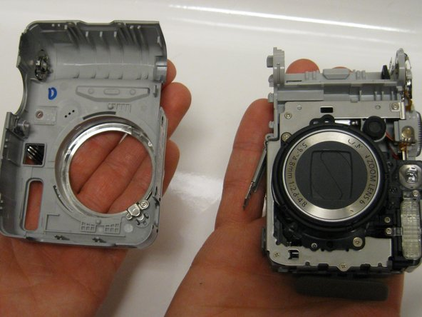 Carefully pull the front panel away from all the interior components of the digital camera.