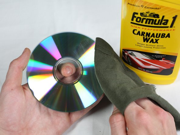 Wipe the CD clean, removing any excess wax.