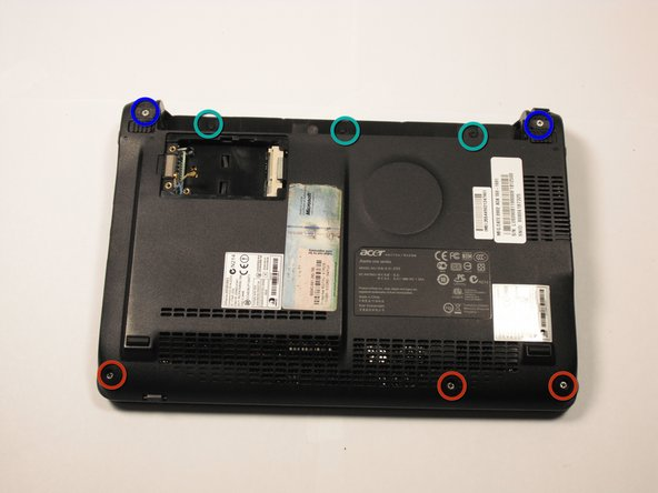 Image 1/2: Remove three 3.9 screws from the netbook with the Phillips #1 screwdriver. Remove the rest of the five screws from the netbook with the Phillips #0 screwdriver