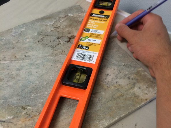 Use this measurement to draw a cut-line on the tile with the pencil. Keep in mind the tile will have space between panels.