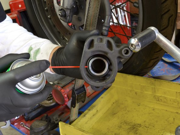 Using a can of brake cleaner, spray out the piston and inside of the brake caliper.