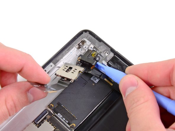 Use a plastic opening tool to help pull the headphone jack out of its recess in the top of the rear panel.