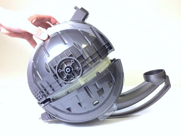 Remove the bottom half of the plastic sphere to reveal the motor.