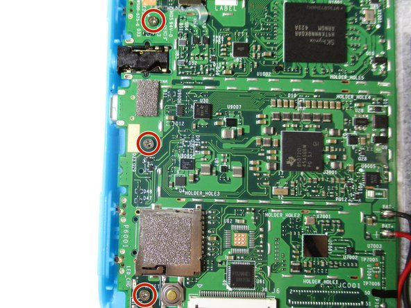Remove the three 4 mm screws on the motherboard with a Phillips #000 screwdriver.