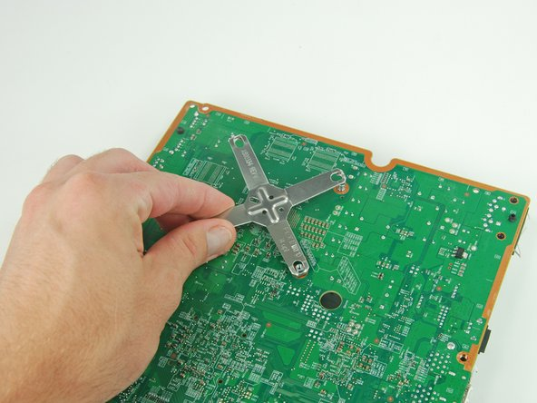 Lift the x-clamp off the back of the logic board.