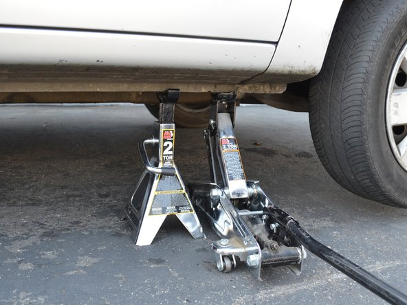 Image 1/3: Lift the car until the jack stand is no longer supporting the car.
