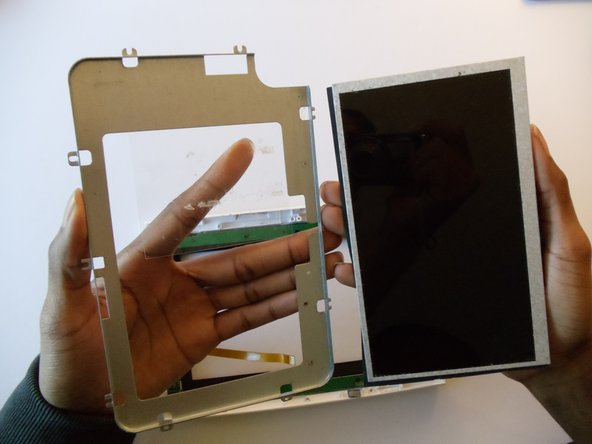 Remove the plastic tape from the back of the screen.