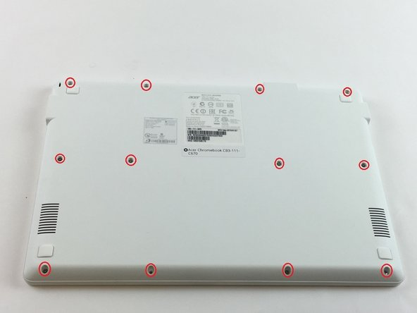 Turn the Chromebook over so that the back panel with the tag and serial number is facing upward.