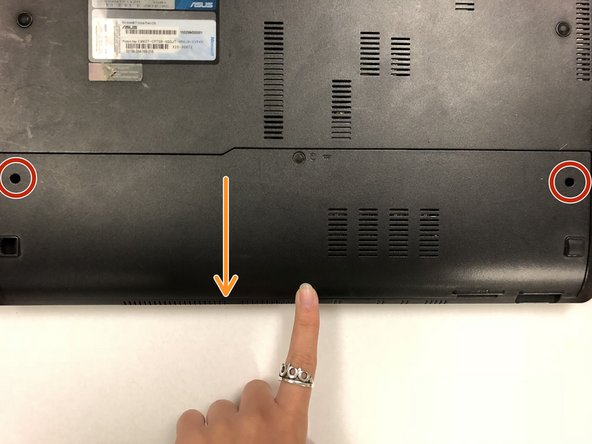 Remove the base of the laptop for access to the hard drive.