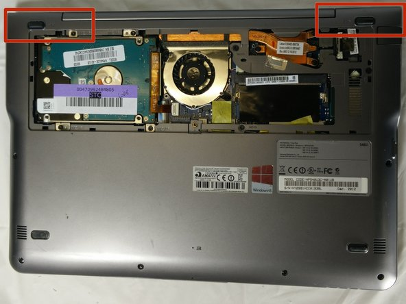 Image 1/2: There are snaps that hold the cover near the fan in place. Be careful not to break these.