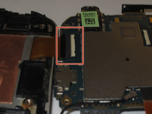 Remove the gold ribbon cable by lifting tab at the back of the socket, using a spudger or tweezers