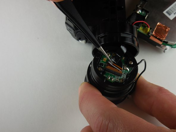 Disconnect the ribbon connector connecting the lens unit to the logic board.