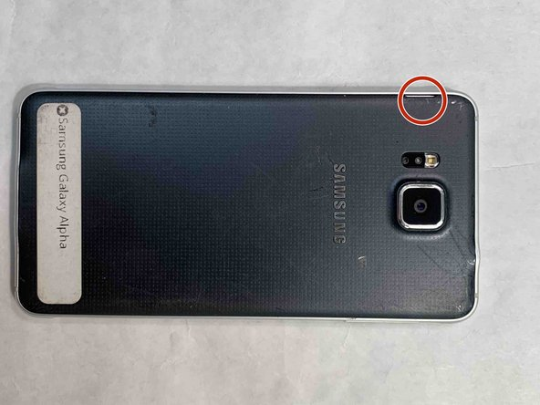 On the back of the phone, find the slot on the side. When looking at the phone upright and from the back, it should be to the left of the camera.