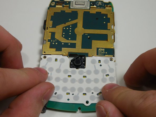Align the new keyboard membrane with gold conduits and press down onto circuit board.