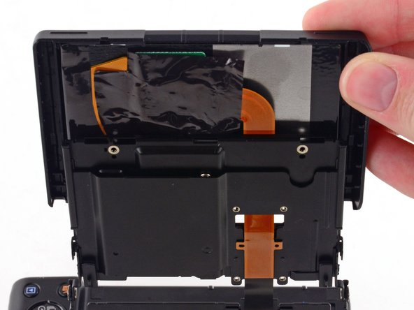 Image 2/3: Do not attempt to fully remove the screen, as it is attached to the assembly by a ribbon cable.