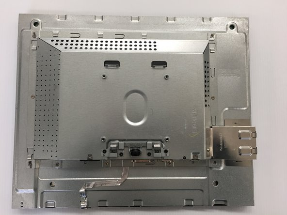 Turn the monitor over. Unscrew the four 4mm x 10mm screws on the back of the monitor and remove the plastic backing.