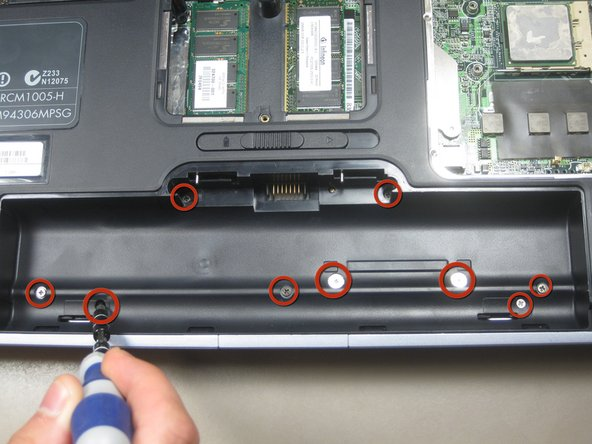 Remove the 9 screws from the battery area.