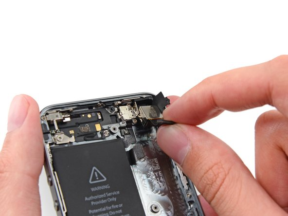 Image 2/3: If the rubber camera bumper has shifted, be sure to replace it before reassembling your iPhone.