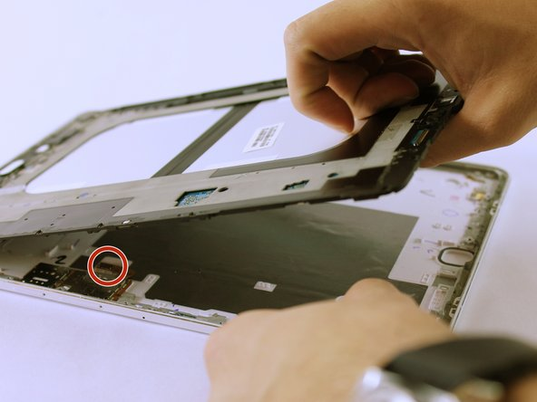 Image 3/3: On the third picture, there is a Sim Card component that is connected to the frame and back cover. As you lift up the frame, it'll detach. This is normal.