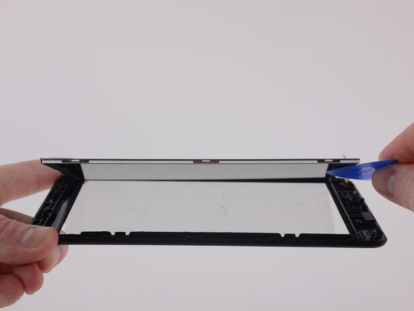The digitizer is fused to the front case but the LCD display can be isolated by unclipping it from the assembly with an opening tool.