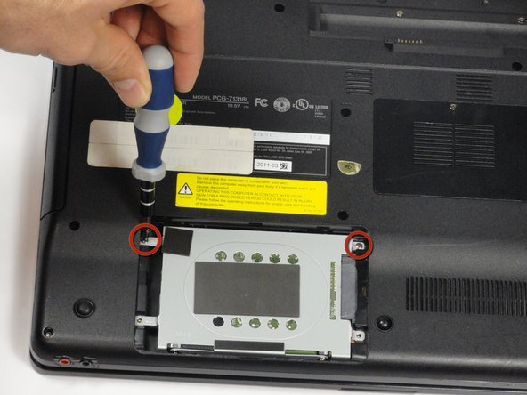 Image 1/1: Remove the two remaining 7.75-mm screws using the Phillips #00 screwdriver.