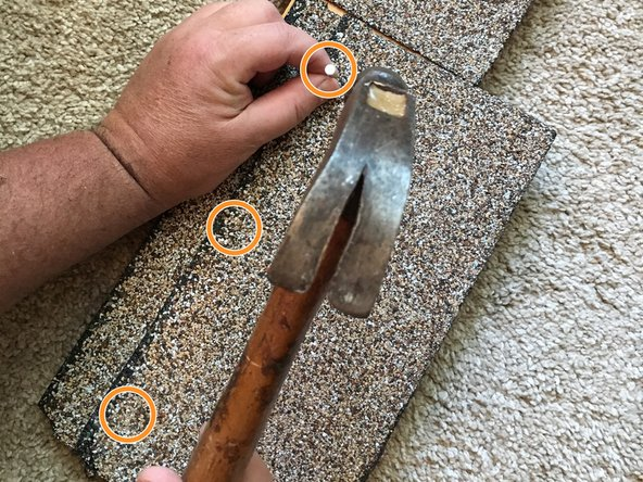"Secure the shingle with three 7/8"" roofing nails."