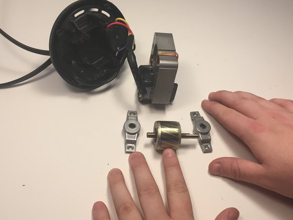 The magnet will slide out of  the motor . Inspect the magnet and motor for anything that may cause a hang-up.