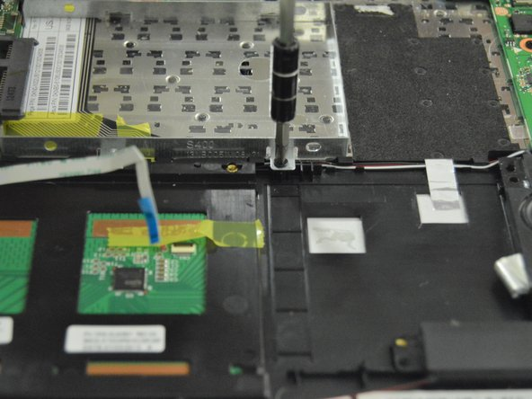 Remove 2 5mm screws from the hard drive casing.
