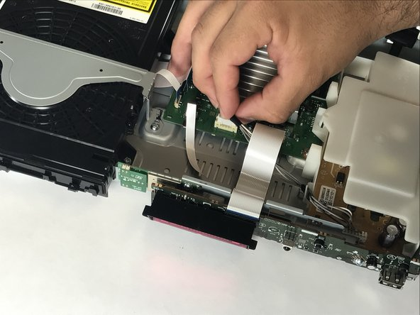 Remove the cable connecting the Power Port to the Motherboard by pulling up.