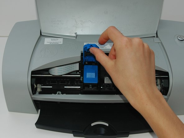 This step shows the black ink cartridge in black and the color ink cartridge in blue. You may need to replace both or only one ink cartridge at a time.
