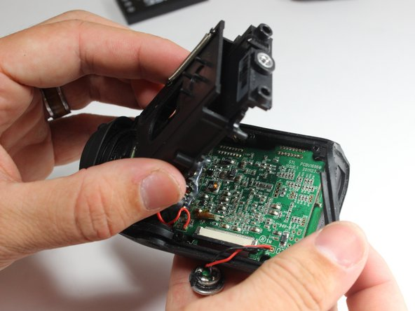 Remove the battery housing from the camera body.