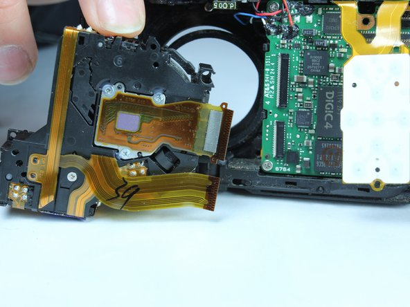Image 3/3: Gently remove the lens for replacement.