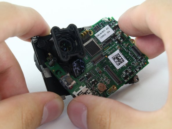 Image 2/3: Separate the LCD assembly by pulling away the motherboard.